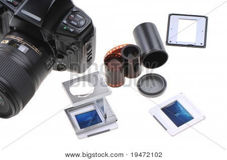 Old timer slide photographer�s lightbox including film, loupe, frames and box. White background studio image.