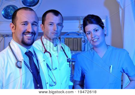 Medical doctors and a nurse at hospital emergency room intensive care - a series of emergency room photos.