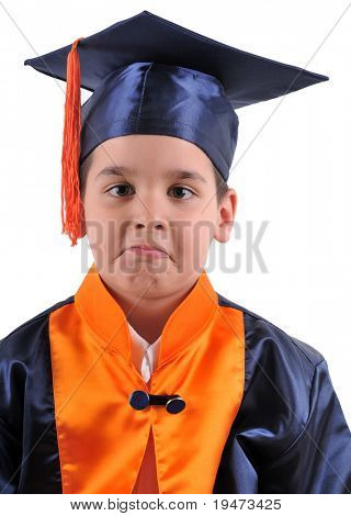 Elementary boy proudly wearing his graduation cap and gown mimicking