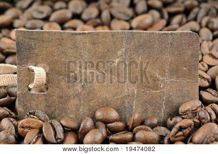 Vintage price tag on coffee background.