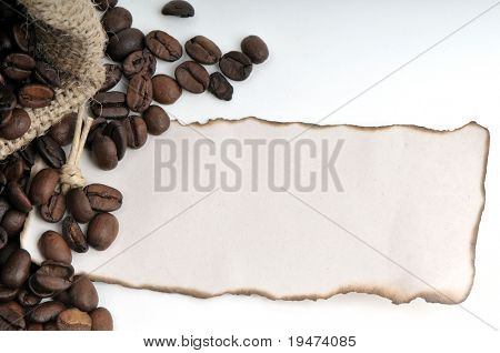 Burned tag on coffee beans background