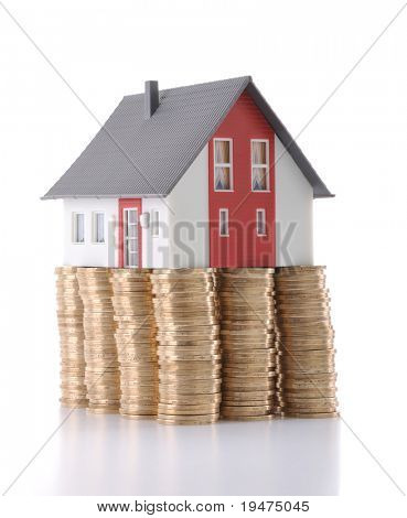 Mortgage concept by money house from coins - a series of COIN HOUSE images.