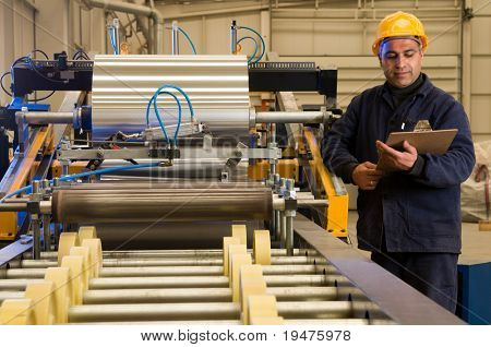 Factory worker processing roll of steel sheet - a series of METAL INDUSTRY images.