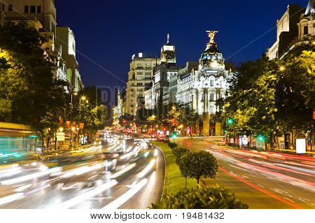 Street traffic in night Madrid, Spain
