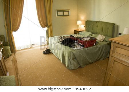Hotel Suite With Open Suitcase