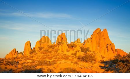 Rocks in Joshua Tree National Park illuminated by sunset, Mojave Desert, California