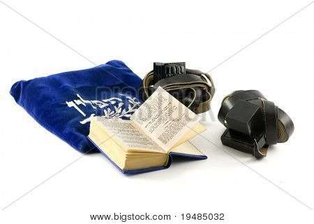 Tefillin - phylacteries worn by Jewish men for morning prayers, Siddur - Jewish prayerbook and bag isolated on white