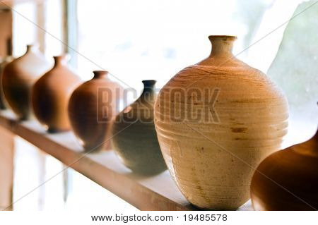 handmade pots/vases on a shelf at workshop