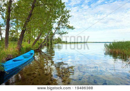 Boat Near The Summer Lake Shore