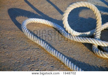 Sailing Rope Laying On The Floor In Sunset