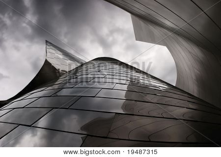 modern metal building with a cloudy sky above