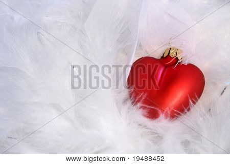 Red heart and white feathery background