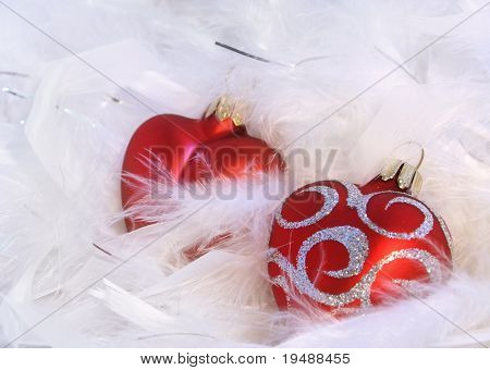 Red hearts and white feathery background