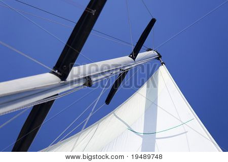 Looking up at sails and mast of boat / yachting