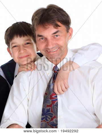 Portrait of smiling middle aged father hugged by young son, isolated on white background.