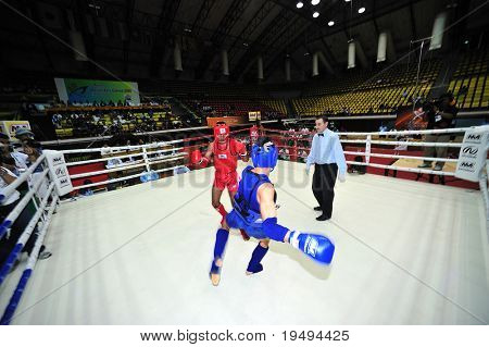 BANGKOK - AUGUST 2: Ali Saher Abdulwahid (L) of Iraq fights Kang Wang of China at Thai boxing event during the 1st Asian martial arts games 2009 August 2, 2009 in Bangkok, Thailand.
