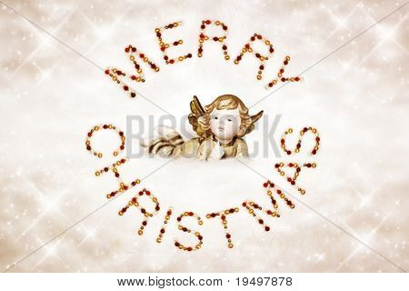 Merry Christmas letters made of Christmas baubles as season's greetings with angel lying on cloud in the center on glitter background