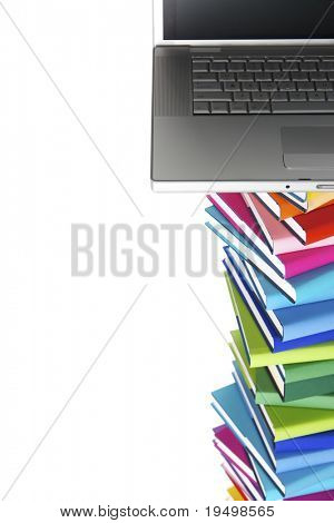 E-learning concept - laptop on top of stack of colorful real books on white background, top view.