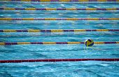 picture of swim meet  - A waterpolo ball floats alone in swimming lanes  - JPG