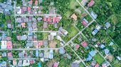Neighborhood With Residential Houses And Driveways poster