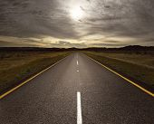 image of tar  - Straight tar road leading into the light  - JPG