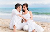 picture of love couple  - Love couple sitting on the beach - JPG