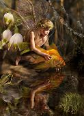 stock photo of orange frog  - The girl releases a gold fish - JPG