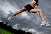 Athletic woman running before the storm