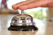 stock photo of dong  - Hand of a man using a hotel bell  - JPG