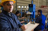 picture of factory-worker  - Inspector checking workers equipment motion blurred  - JPG