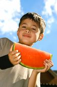 Young Boy Showing A Slice Of Watermelon Outdoor poster