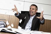 picture of pissed off  - Overloaded senior businessman being upset about work - JPG