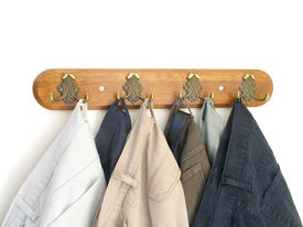 picture of clothes hanger  - some pants hung neatly on a row of hooks - JPG