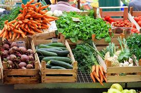 stock photo of farmer  - Fresh and organic vegetables at farmers market - JPG