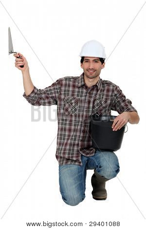Builder with bucket and trowel