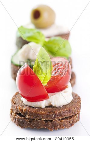 Canapes with tomato and olives