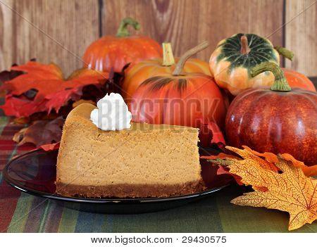 Pumpkin Cheesecake In Autumn Setting
