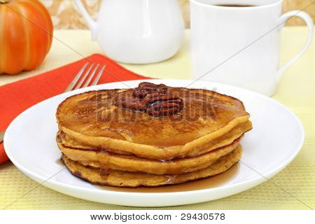 Pumpkin Pancakes With Pecans And Syrup.