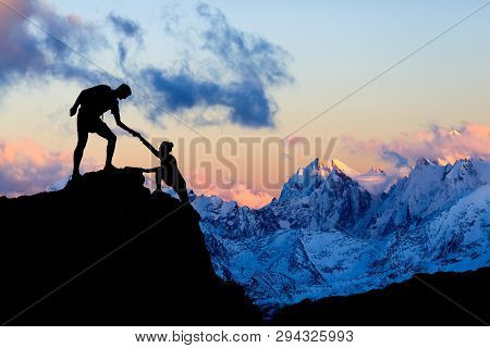 poster of Teamwork Couple Helping Hand, Trust In Mountains. Team Of Climbers Man And Woman Hiking, Help Each O