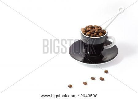 Espresso Cup And Saucer Containing Coffee Beans Isolated On White Background With Clipping Path
