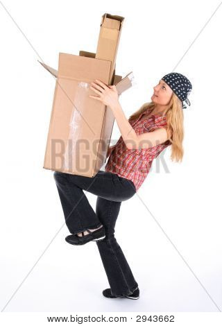 Girl Balancing With Cardboard Boxes