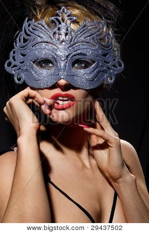 Close up shot of gorgeous Incognito woman in ancient style mask