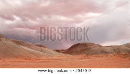 Sand Dunes Under A Dramatic Sky Near Monument Valley