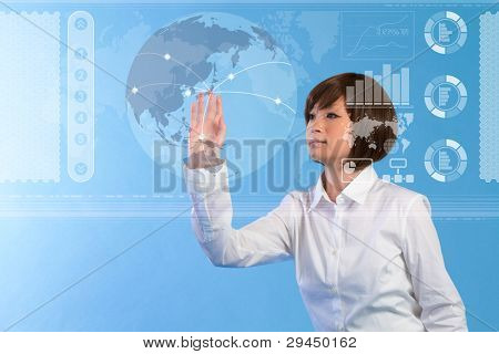 Beautiful business woman pushing touch screen.