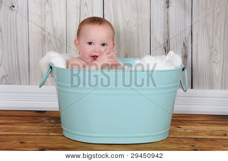 Adorable Baby Sitting In Hapily Green Washtub