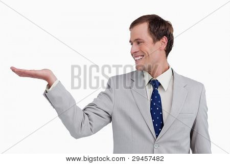 Close up of smiling businessman looking at his palm up against a white background