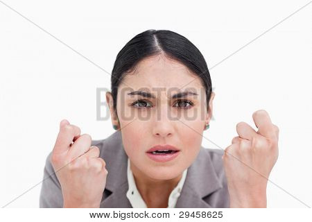 Close up of disappointed looking businesswoman against a white background