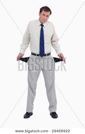 Sad businessman showing his empty pockets against a white background