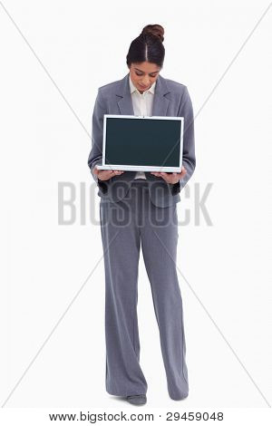 Female entrepreneur looking at her laptop in her hands against a white background