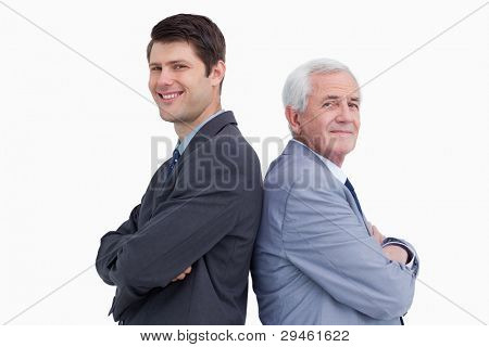 Close up of businessman and his mentor standing back to back against a white background